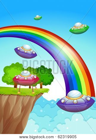 Illustration of the flying saucers in the sky near the rainbow