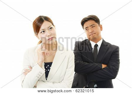 Disappointed businessman and businesswoman