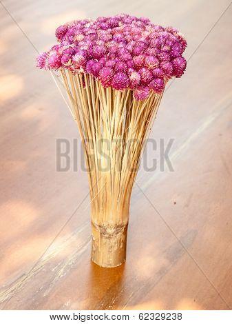 Globe amaranth flower and bamboo decoration