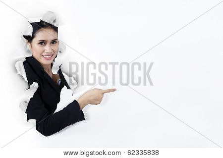 Businesswoman Pointing At Copyspace On Paper Wall