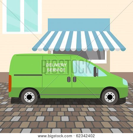 Green delivery Van stayed near a cafe poster