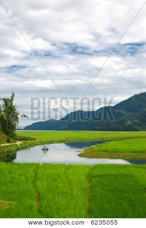 Farmers in the water reflection of fewa lake, nepal
