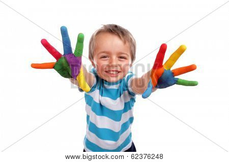 Boy with hands painted in colorful paints ready to make hand prints