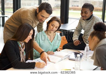 Group Of Young Students Studying Together