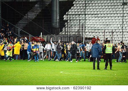 Football Hooligans Run On The Soccer Field