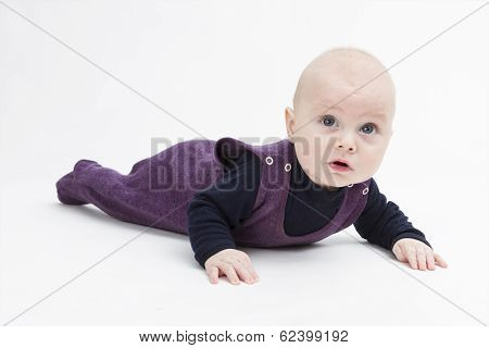 Toddler In Dark Clothing Crawling