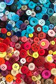 pile of assorted Colourful Sewing buttons background colours poster