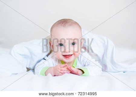 Adorable Funny Laughing Baby Playing Peek-a-boo Under A White Blanket In A Sunny Bedroom