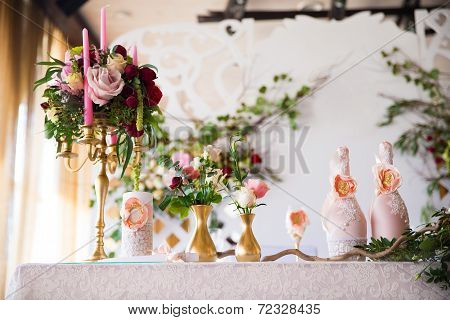 Floral Arrangement To Decorate The Wedding Feast, The Bride And Groom. Flowers, Candles, A Bottle Of
