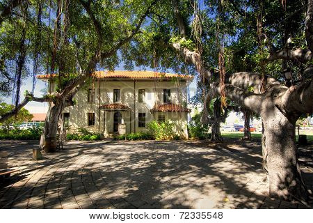 Old Courthouse and Banyan tree in courtyard square. Lahaina Harbor on Front street, Maui, Hawaii