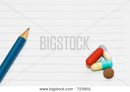 notepad, one pencil, pills