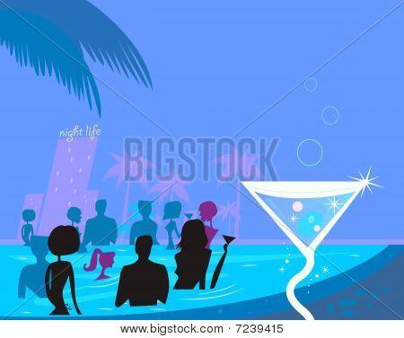 Water party night: People in pool & fresh Martini