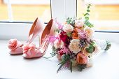 Wedding accessories for the morning of the bride in pink . Wedding bouquet and shoes of the bride. poster