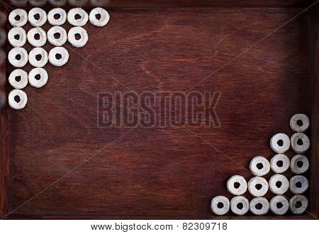 Cheerios Lined As Two Angles Into Dark Wood Box