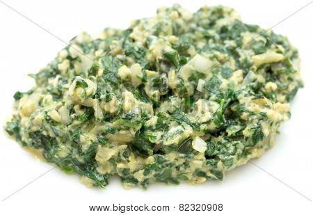 Scrambled egg with spinach, onion and basil. Italian style uova strapazzate al verde, on a white plate. poster