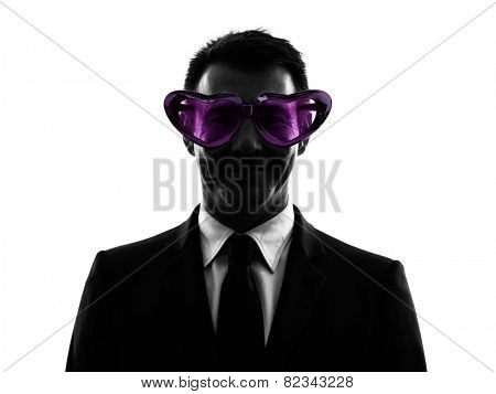 one caucasian business man loving with funny glasses in silhouette on white background