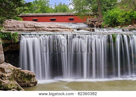 Waterfall And Red Covered Bridge