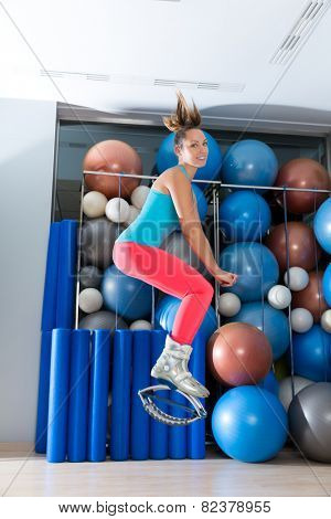 Kangaroo jumps anti gravity fitness boots girl at gym indoor