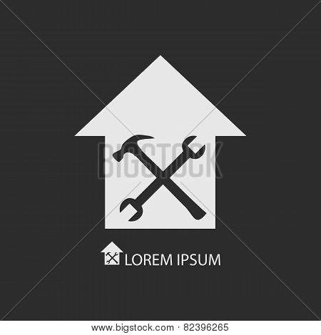 White house repair symbol on dark grey