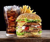 Hamburger, potato fries, cola drink. Takeaway food. poster