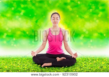 Beautiful Young Woman Practicing Yoga, Sitting In A Lotus Position