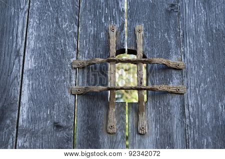 Old Wooden Door With Metal Grid Peephole
