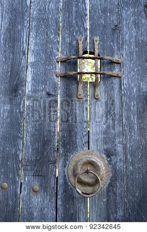 Old Wooden Door With Metal Grid Peephole And Hinge