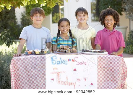 Group Of Children Holding Bake Sale