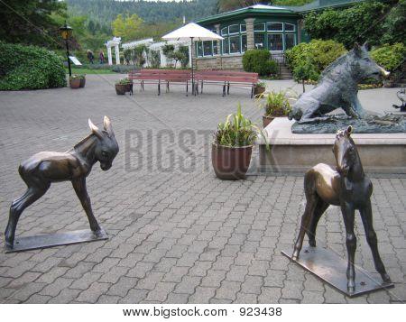 Little Bronze Ponies And Wild Boar