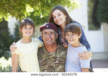 Portrait Of Soldier Returning Home With Family