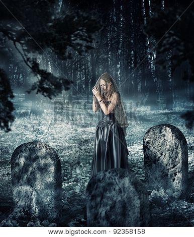 Woman In Black Dress Praying On Cemetery