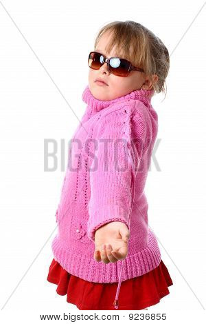 Small girl in pink sweater having a dilemma looking at camera isolated on white