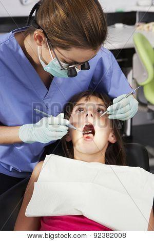 Girl Having Dental Check Up With Female Dentist
