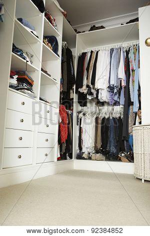 Tidy Teenage Bedroom With Neat Wardrobe