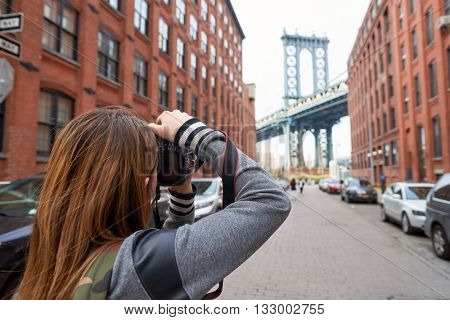 NEW YORK - CIRCA MARCH, 2016: woman taking photos in New York. The City of New York, often called New York City or simply New York, is the most populous city in the United States