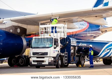 MOSCOW, RUSSIA - SEPTEMBER 18, 2015: Airport Gazprom company workers refueling the aircraft
