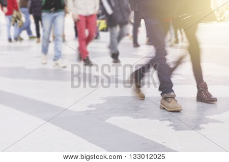 blur abstract people background unrecognizable silhouettes of people walking on a street