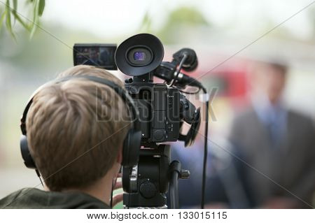 Cameraman. Filming an event with a video camera.