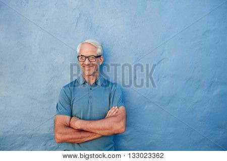 Happy Mature Man Standing With His Arms Crossed