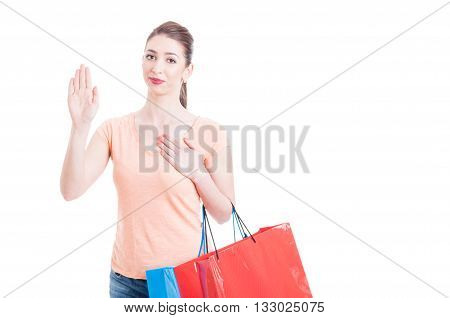 Young Lady With Shopping Bags Showing Swearing Or Promising Gesture