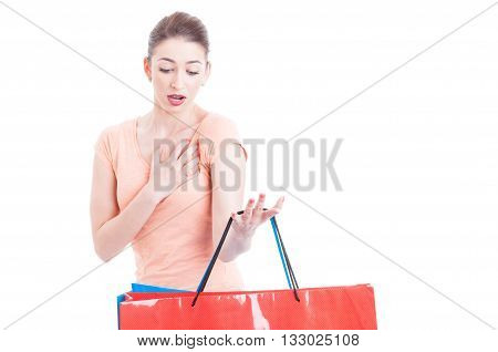 Woman Carrying Shopping Bags Feeling Shocked Or Indignant