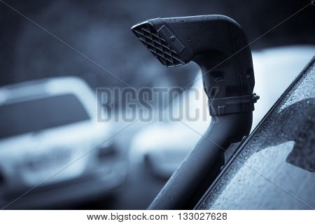 Close up shot of an off road car air intake called snorkel.