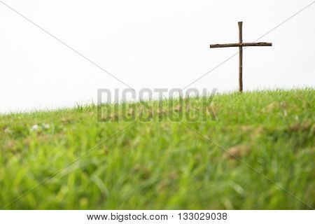 Wooden Cross On A Hill