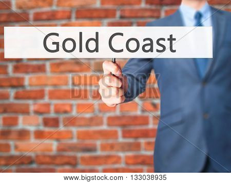 Gold Coast - Businessman Hand Holding Sign