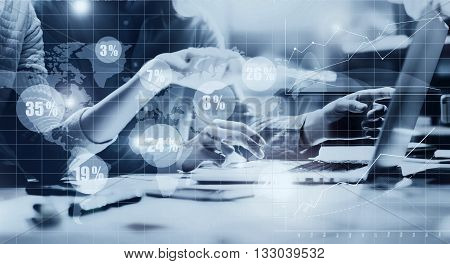 Business team meeting.Photo young crew working new startup project.Notebook wood table.Idea presentation, analyze marketing plans.Digital Connections World Wide Interfaces Graphics Screen.Black white