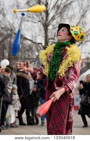 VILNIUS - MARCH 6: Unidentified juggler in annual traditional crafts fair - Kaziuko fair on March 6 2016 in Vilnius Lithuania. Saint Casimir's Fair is a large annual folk arts and crafts fair.