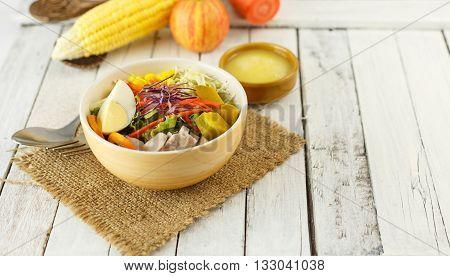 Bowl Of Fresh Vegetables Salad On White Wood