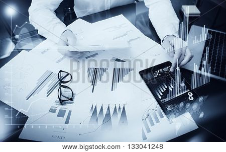 Sales Management Time Process.Photo trader work market report documents.Use electronic devices.Work graphics icons, stock exchanges reports interfaces.Business project startup.Horizontal, black white