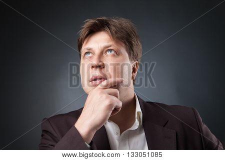 portrait of pensive adult man looking up.studio shot