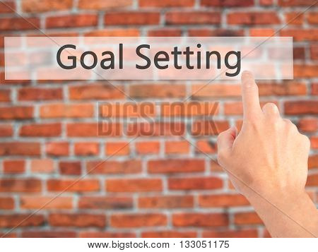 Goal Setting - Hand Pressing A Button On Blurred Background Concept On Visual Screen.